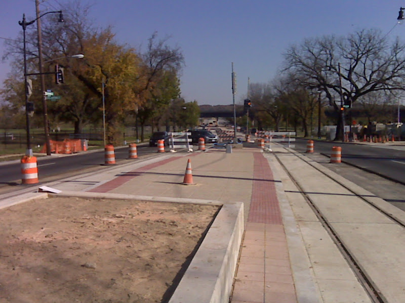 raised planting bed and streetcar platform.  Note the left turn lane for westbound traffic turning south on Oklahoma.