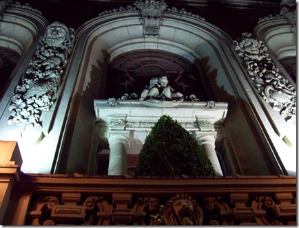 038 night shot of cherubs on side of Adolphus Hotel