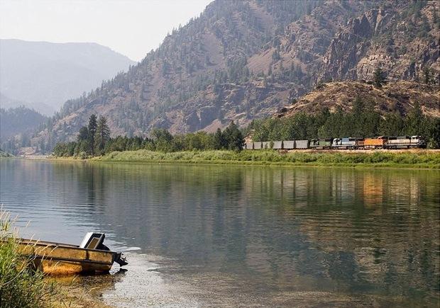 Train runs through the green at Perma, Montana, USA