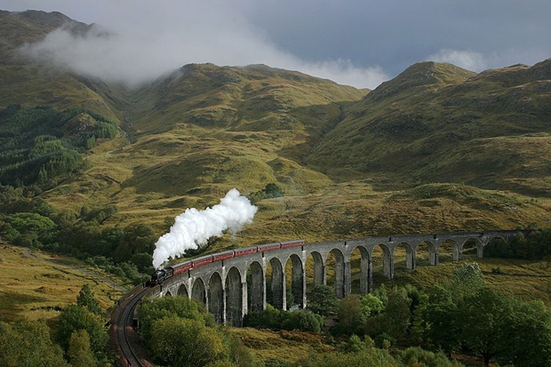 A lucky break in the clouds catches the K1 on Glenfinnan viaduct in the last week of the Jacobite Steam Train season at Fort William, UK