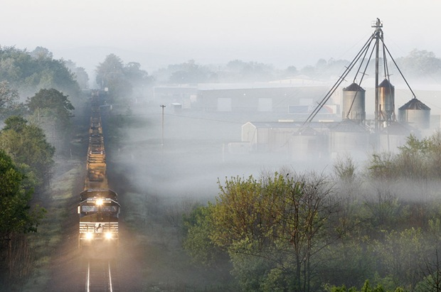 23R Train runs north in the mist in Ranson, West Virginia, USA