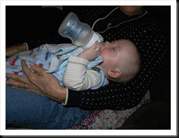 Dean sleep-feeding himself with Aunt Cathy