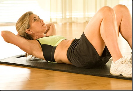 webmd_photo_of_trainer_doing_crunches