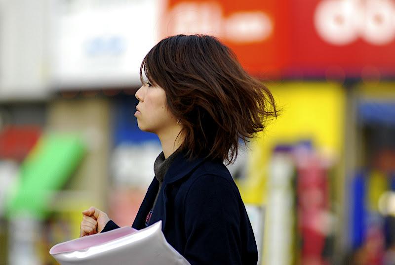 Very, very few people walk fast enough in Tokyo so that their hair flies behind them.