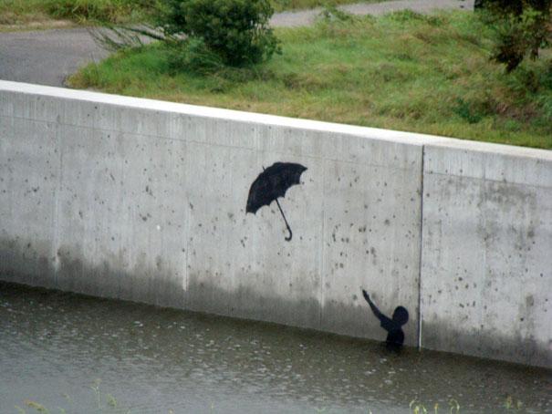 http://lh3.ggpht.com/_9F9_RUESS2E/SsXjt51-hYI/AAAAAAAABSY/drIIvtZ3wfs/s800/banksy-graffiti-street-art-boy-umbrella.jpg
