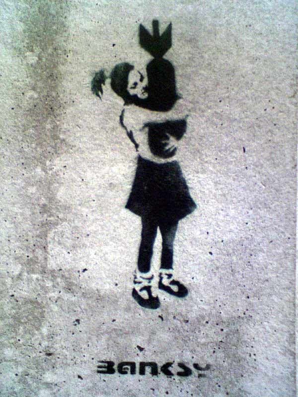 http://lh3.ggpht.com/_9F9_RUESS2E/SsYYnszOhDI/AAAAAAAABTA/a6wOIURxToc/s800/banksy-graffiti-street-art-girl-with-a-bomb.jpg