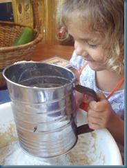 Katherine sifting flour
