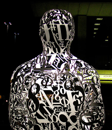 sculpture of a guy made of numbers, lit from within