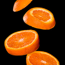 by Christa van Rooyen - Food & Drink Fruits & Vegetables ( orange, fruit, slices, floating )