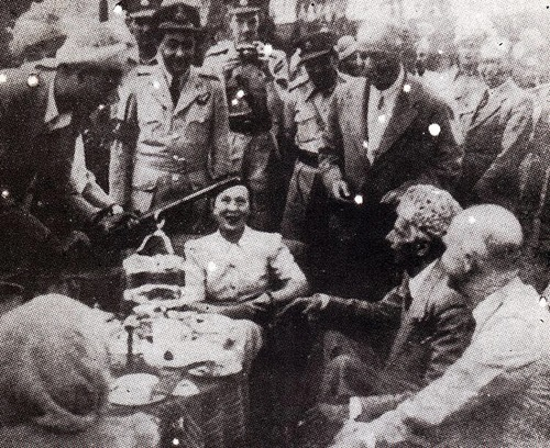 Quaid-e-Azam receiving a rifle from a tribal chief