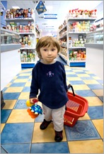 Small girl busy with shopping.