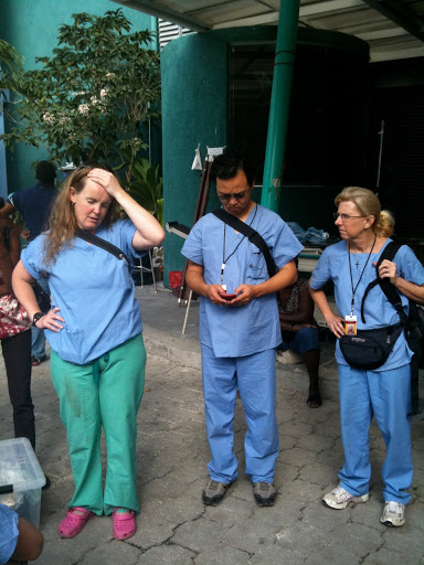 Trauma surgeon, Kate, our team leader, Enoch, and our occupational therapist, Cheryl