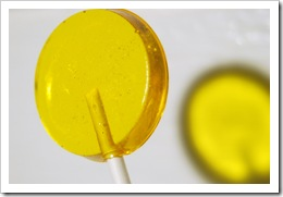 tight closeup of electric yellow lollipop