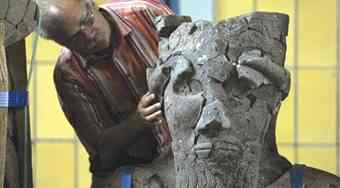 Archeologist Lutz Martin works on a statue from the Tell-Halaf project in Berlin.