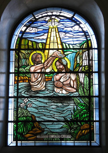 Malate Church stained glass window depicting the baptism of Jesus
