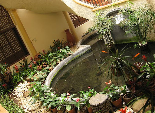 small koi pond in the refectory of Caleruega in Batangas