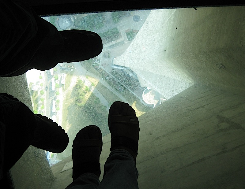 Exie and Hilda's feet on the glass floor of the CN Tower