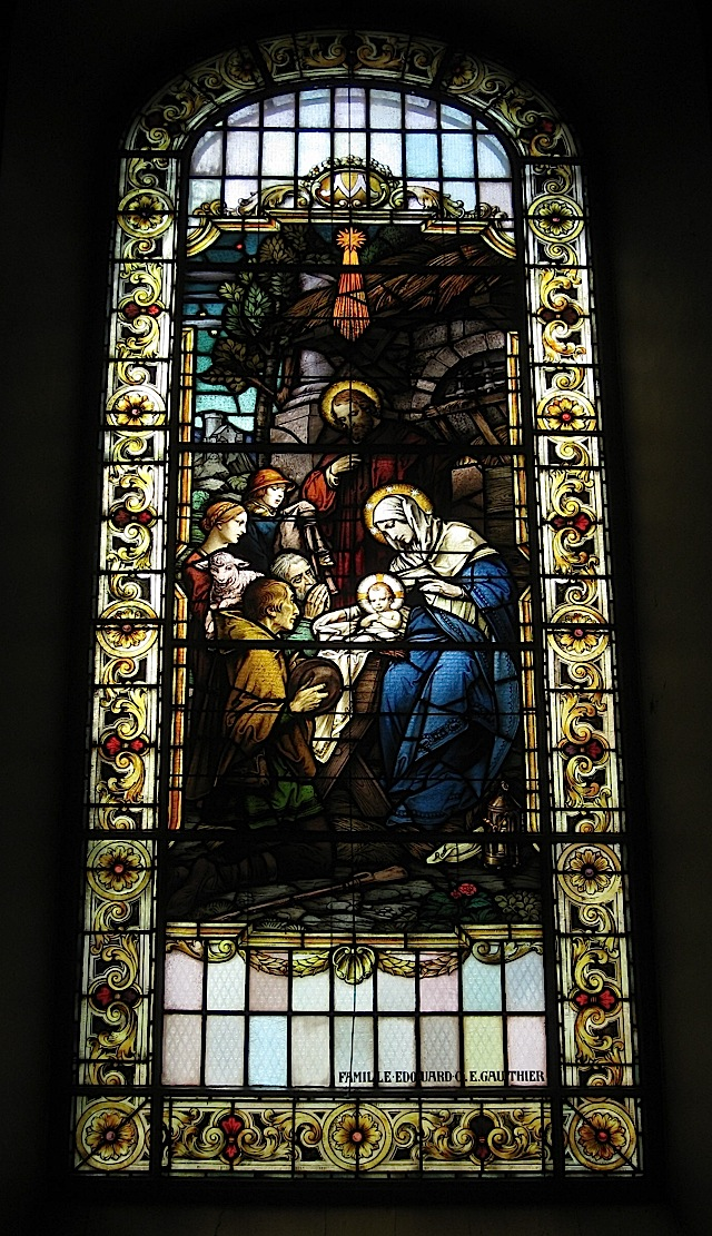 stained glass window at the Notre-Dame de Québec depicting the birth of Jesus