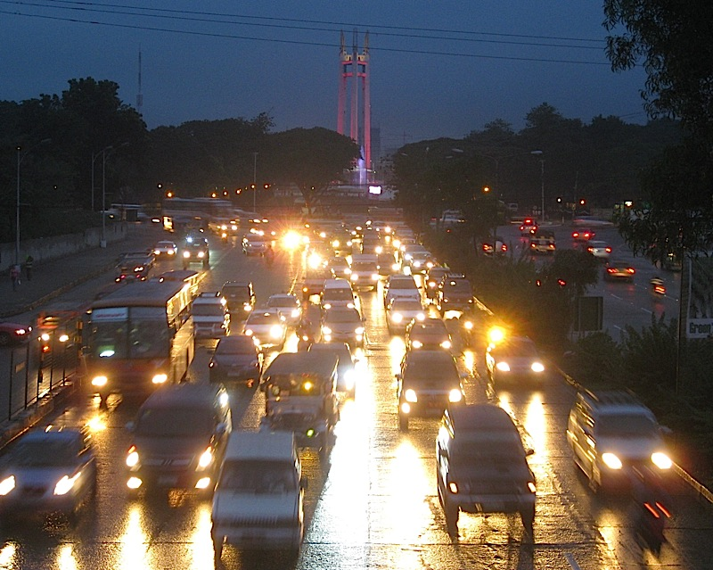 the fountain and monument of the Quezon Memorial with colored lights for Noynoy Aquino's inaugural street party