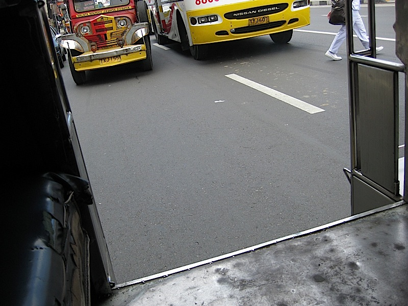 looking at the street from inside a jeepney