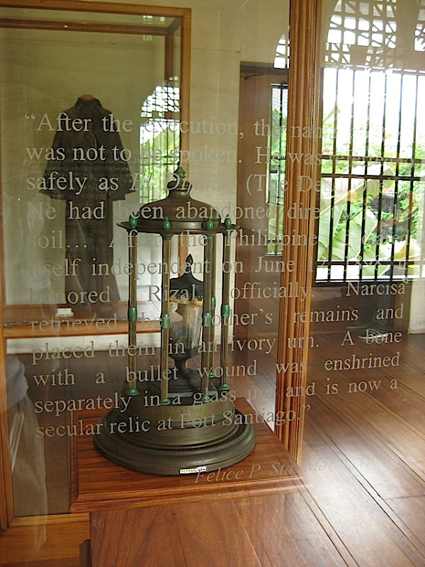 glass urn in a glass case which holds a bone of Philippine National Hero Jose Rizal
