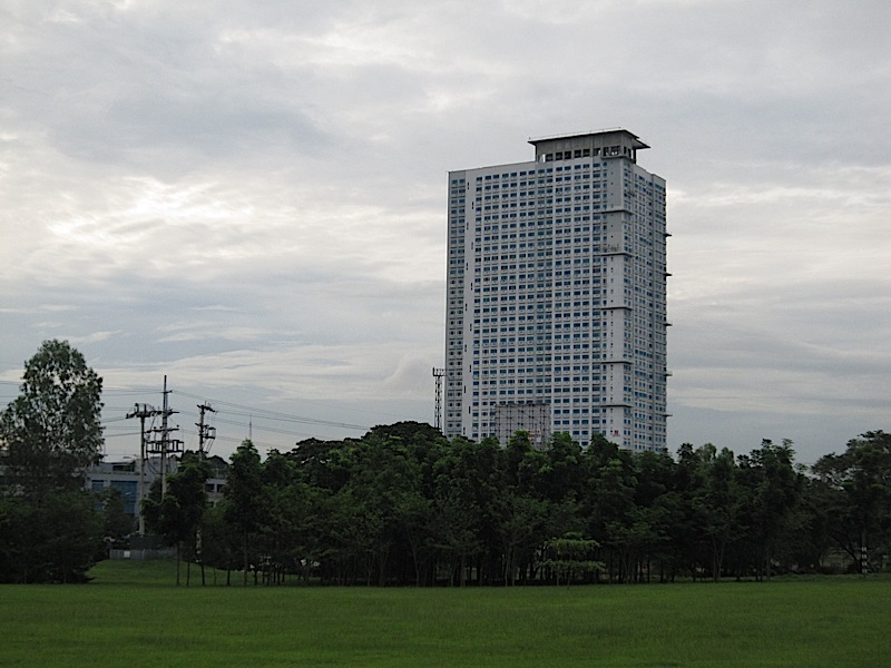 Berkeley Residences seen across a field of Ateneo de Manila University
