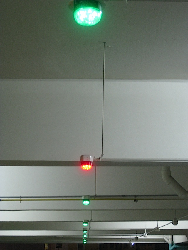 red and green lights in a parking building