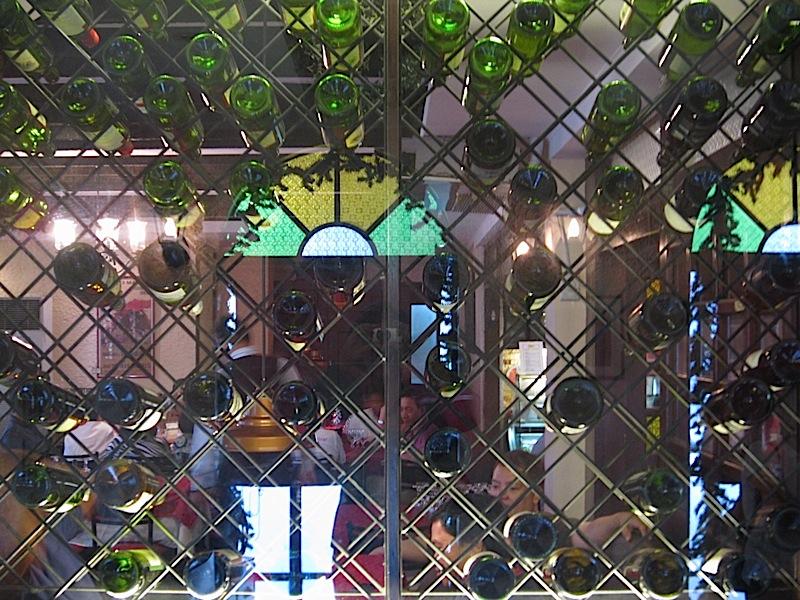 wine bottle holder in the wall of Alba Restaurante Español