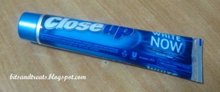 close up white now toothpaste tube, by bitsandtreats