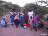 Mensen bij de waterkraan