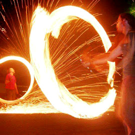 Fire dancing in the street by Hrodulf Steinkampf - People Musicians & Entertainers ( poi, flames, fire stick, fire dancing, sparks, fire )