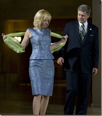 Laureen Harper (L), the wife of Canadian Prime Minister Stephen Harper (R), adjusts her scarf as they arrive for Tanabata Ceremony at the Windsor Hotel Toya Resort and Spa in Toyako, Japan, July 7, 2008 during the G-8 Summit.  the             AFP  PHOTO/Jim WATSON (Photo credit should read JIM WATSON/AFP/Getty Images)