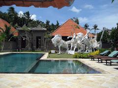 Swimming pool at hotel Puri Rai