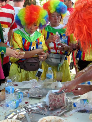 Runners dressed like clowns during the Marathon du Medoc in France