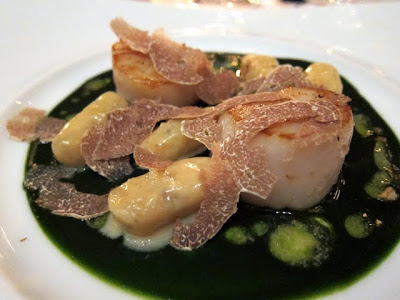 Scallops with gnocchi and white truffle at the three Michelin starred Restaurant Gastronomique in Paris