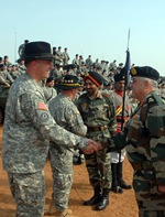 Indian army Maj. Gen. Anil Malik, general officer commanding, 31st Armored Division and keynote speaker at the opening ceremony for Exercise Yudh Abyas 09, greets U.S. Army Lt. Col. Jim Isenhower, commander, 2nd Squadron, 14th Cavalry Regiment, 2nd Stryker Brigade Combat Team, based in Schofield Barracks, Hawaii, at the opening ceremony for exercise Yudh Abhyas, at the Babina Indian army base, Oct. 12. YA09 is an annual bilateral exercise between the armies of India and the U.S. This year marks the first time in the history of the exercise in which two mechanized units participate.
