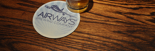image of Airways Brewing Company coaster and glass courtesy of our Flickr page