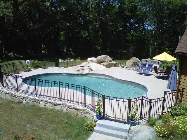 oasis vinyl liner pool with waterfall and paver patio Gloucester MA