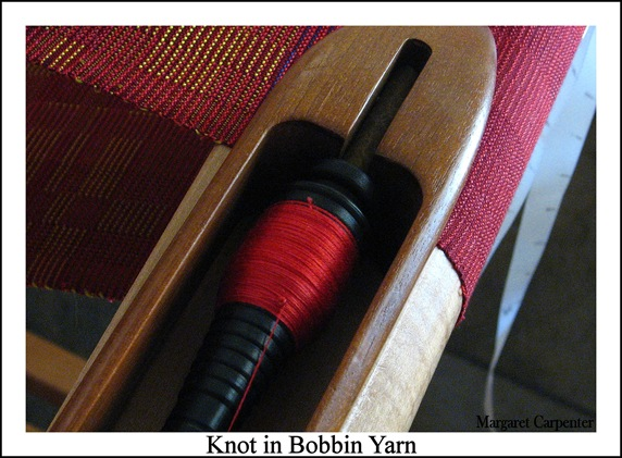 Knot in bobbin yarn