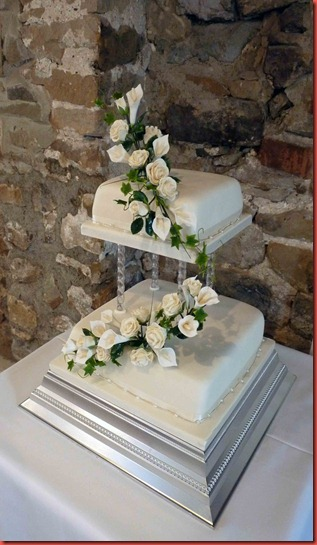 2-tier-Draped-Roses-and-Lillies-wedding-cake-set-up-at-tempest