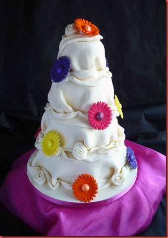 4-tier-Chocolate-ruffle-abd-Coloured-Gerbera-wedding-cake