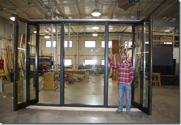 aluminum clad tri pivot door