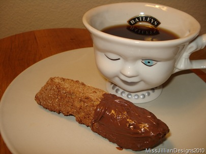 biscotti dipped in nutella with coffee on the side