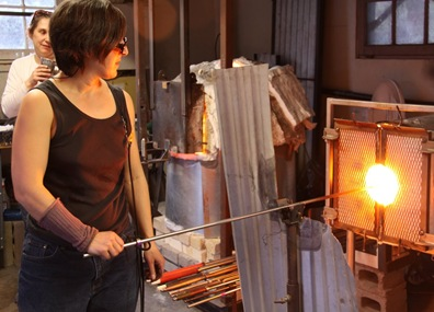Glass Blower heating the glass.