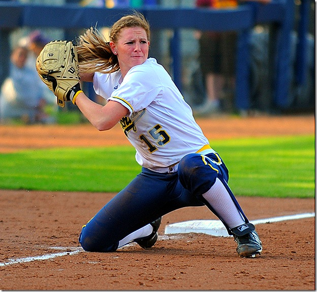 Michigan third baseman Maggie Viefhaus throws from her knees after stabbing a line shot down the third base line during fifth inning action of the Wolverine's 8-0 win over Central Michigan University, Wednesday evening, April 14th at UM's Alumni Field.