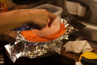 picture of foil over pie crust being filled with dried beans