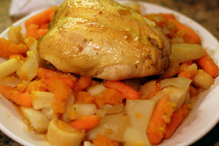 picture of roasted chicken breast with root vegetables