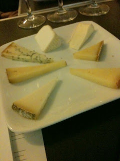 picture of six elegantly arranged cheeses from Murray's