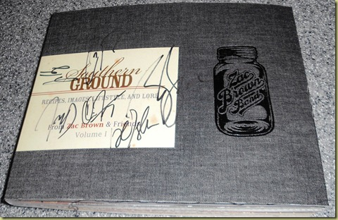 Autographed front cover of the Zac Brown Band cookbook.