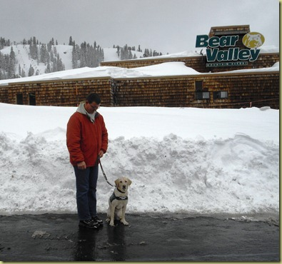 Tony and Reyna standing out front of Bear Valley Ski Resort.  The Bear Valley Ski Resort sign is in the back ground